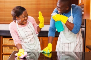 african couple having fun while doing household chores