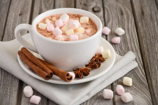 Hot chocolate with marshmallows on the rustic wooden table