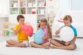 Kids blowing large balloons